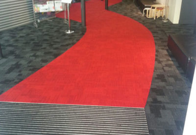 The Auckland Performing Arts Centre Inzide Carpet Tiles With A Free Hand Drawn Red Walkwa